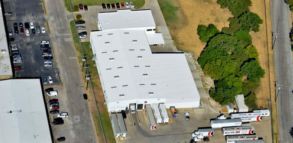 building with white TPO Roofs in Dallas Texas
